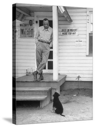Boxer Joe Walcott Standing Outside Doorway of Building at Training Camp