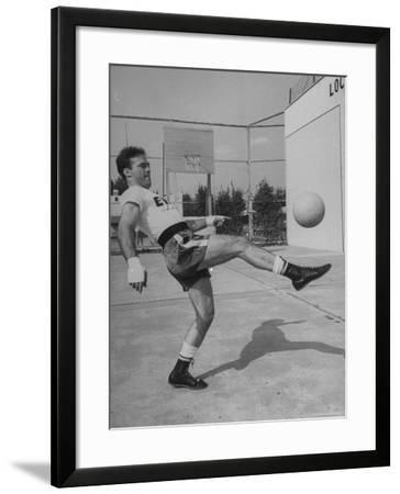 Boxer Marcel Cerdan, Trying to Achieve Hairline Balance by Bouncing a Soccer Ball