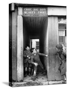 Children Playing at the Entrance to McGee's Court Slum on Camden Street by Tony Linck