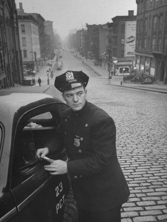 Ny Patrolman James Murphy Standing by His 23 Precinct Squad Car on Street of His East Harlem Beat