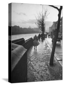 People Walking Through Dublin in the Rain by Tony Linck