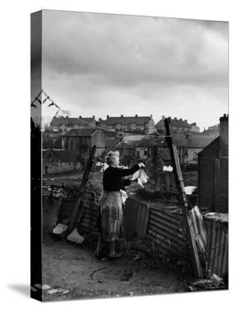 Woman Hanging Wash in a Dublin Slum