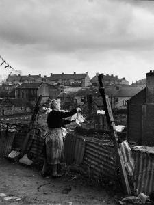Woman Hanging Wash in a Dublin Slum by Tony Linck