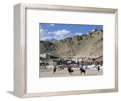 Game of Polo on Leh Polo Field, Tsemo Gompa on Ridge Behind, Leh, Ladakh, India