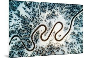Top Aerial View of Snow Mountain Landscape with Trees and Road. Dolomites, Italy.