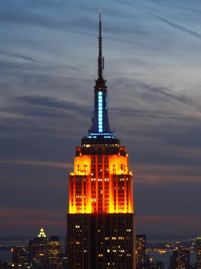 Top Of The Empire State Building Illuminated At Night In