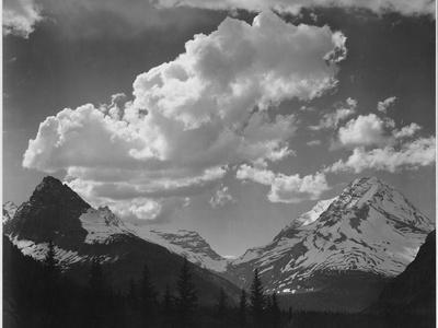 https://imgc.artprintimages.com/img/print/tops-of-pine-trees-snow-covered-in-glacier-national-park-montana-1933-1942_u-l-q19qm4q0.jpg?p=0