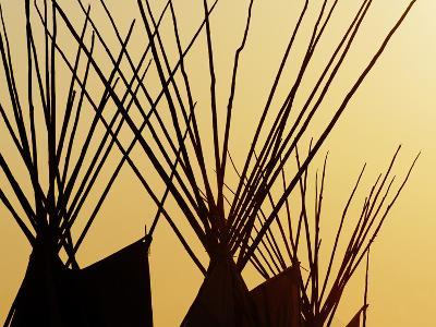 Tops of Tepees Silhouetted at Sunset, Montana-Adam Jones-Photographic Print
