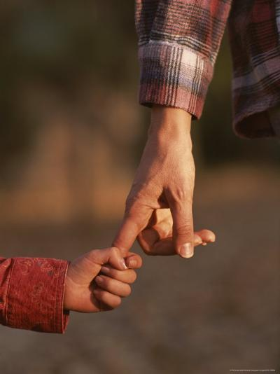Touching Close-up of a Mother and Daughter Holding Hands-Phil Schermeister-Photographic Print
