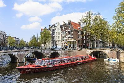 Tourist Boat Crossing Keizersgracht Canal, Amsterdam, Netherlands, Europe-Amanda Hall-Photographic Print