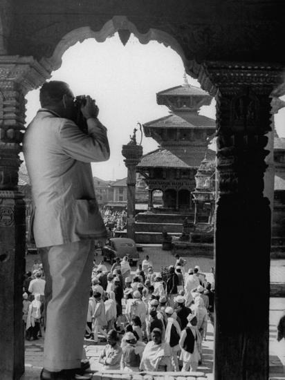 Tourist in Nepal Taking a Picture of a Temple--Photographic Print