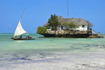 Tourist on a Traditional Dhow Boat, the Rock Restaurant, Bwejuu Beach, Zanzibar, Tanzania-Peter Richardson-Photographic Print