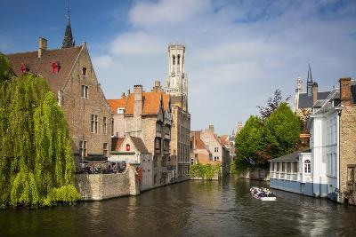 Tourist on Boat Ride Through the Canals of Bruges, Belgium-Brian Jannsen-Photographic Print