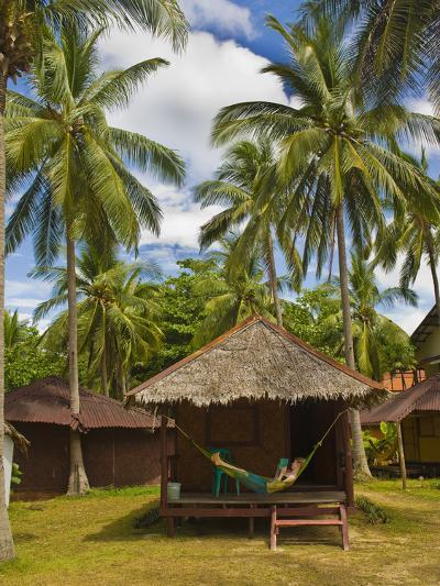 Tourist Relaxing in a Hammock on a Bamboo Beach Hut on the Thai Island of Koh Lanta, South Thailand-Matthew Williams-Ellis-Photographic Print