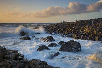 Tourist Watching the Setting Sun on the Giant's Causeway, County Antrim, Northern Ireland-Brian Jannsen-Photographic Print