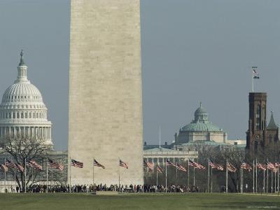 Tourists and Flags Surrounding the Base of the Washington Monument--Photographic Print