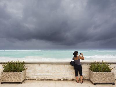 Tourists Come to the Beach to See Hurricane Igor's First Outer Bands-Mike Theiss-Photographic Print