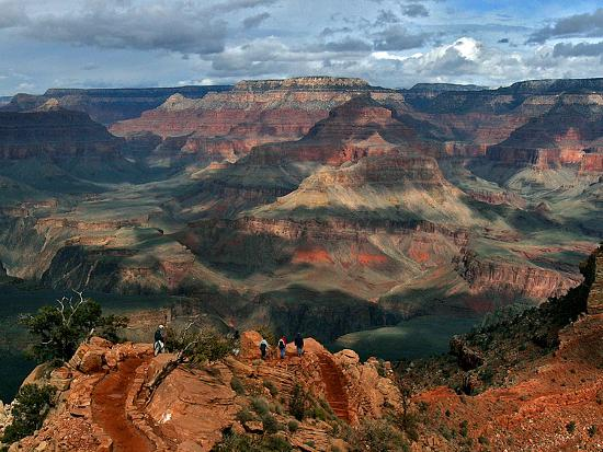 Tourists Hike Along the South Rim of the Grand Canyon--Photographic Print