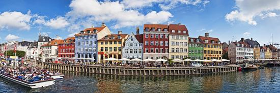 Tourists in a Tourboat with Buildings Along a Canal, Nyhavn, Copenhagen, Denmark--Photographic Print