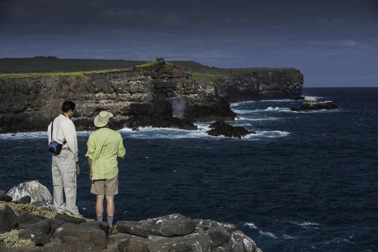 Tourists Looking at the Sea Cliffs of Espanola Island-Jad Davenport-Photographic Print