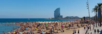 Tourists on the Beach with W Barcelona Hotel in the Background, Barceloneta Beach, Barcelona--Photographic Print