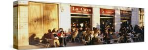 Tourists Sitting Outside of a Cafe, Barcelona, Spain