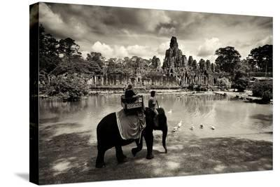Tourists Travel by Elephant on the Grounds of the Temple, Bayon-Jim Ricardson-Stretched Canvas Print