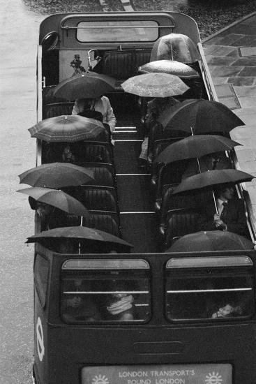 Tourists under Umbrellas on Open Top Bus, 1976-Kent Gavin-Photographic Print