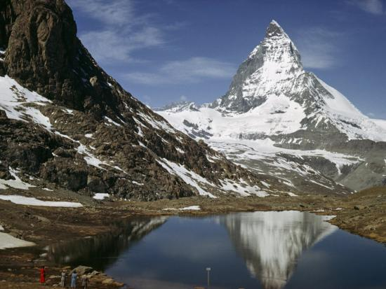 Tourists View the Matterhorn and its Reflection in Alpine Lake-Willard Culver-Photographic Print