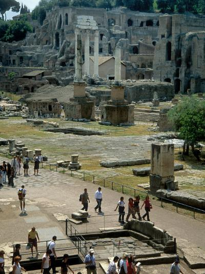 Tourists Walk Through Rome's Ancient Forum with Palatine Hill Behind-O^ Louis Mazzatenta-Photographic Print