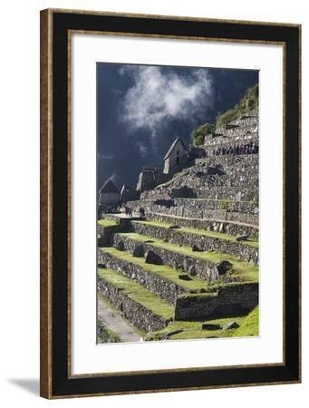Tourists Walking Among the Incan Ruins at Machu Picchu-Gabby Salazar-Framed Photographic Print