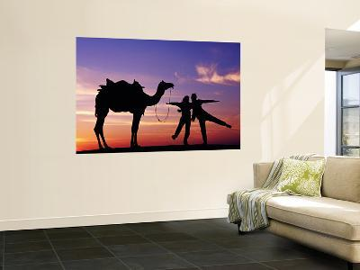 Tourists with Camel Silhouetted at Sunset at Sam Sand Dunes in Great Thar Desert.-Richard l'Anson-Wall Mural