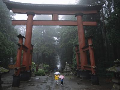 Tourists with Umbrellas Walk under an Arch at the Base of Mount Fuji-Karen Kasmauski-Photographic Print