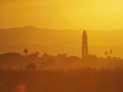Tower Silhouetted Amongst Orange Mountains-Design Pics Inc-Photographic Print