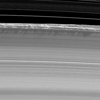 Towering Walls of Ice Rubble Cast Long Shadows on the Outer Edge of Saturn's B Ring--Photographic Print