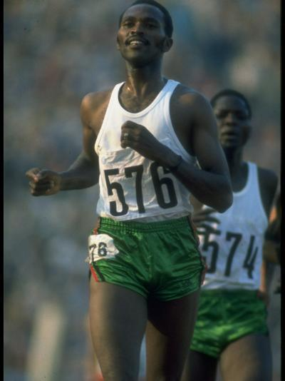Track Athlete Kip Keino in Action at the Summer Olympics-John Dominis-Premium Photographic Print