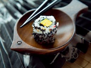 Traditional Japenese Cuisine of Sushi Roll on Dish
