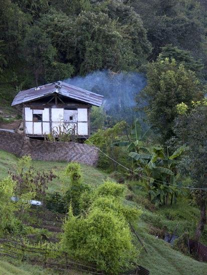 Traditional Small Bhutanese House with Smoke Coming from Roof from Open Fire Inside, Near Trongsa, -Lee Frost-Photographic Print
