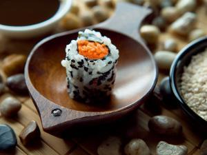 Traditional Sushi Roll in Wooden Dish