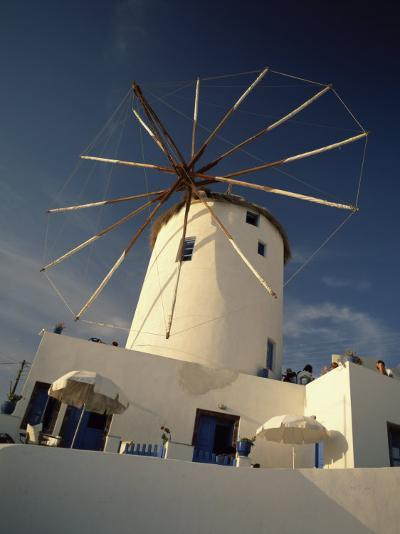 Traditional Thatched Windmill in the Village of Oia, Santorini, Cyclades Islands, Greek Islands-Lee Frost-Photographic Print
