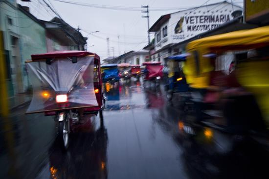 Traffic Headlights Swirl Past an Auto Rickshaw on a Rainy Night in an Amazon River Town-Jason Edwards-Photographic Print