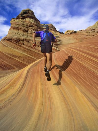 Trail Runner on Sandstone, Coyote Buttes, Utah, USA-Chuck Haney-Photographic Print