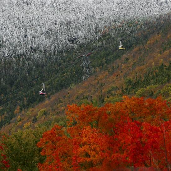 Tram Cars Take Tourists Up Cannon Mountain in New Hampshire as Snow Meets with Changing Leaves--Photographic Print