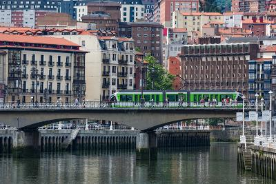 Tram Crossing the River Nervion in Bilbao, Biscay (Vizcaya), Basque Country (Euskadi)-Martin Child-Photographic Print