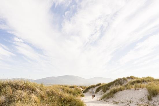 Tramore Beach, Kiltooris, Portnoo, Donegal, Ireland: Woman Walking Through The Dunes Towards Beach-Axel Brunst-Photographic Print