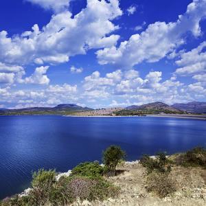Tranquil Lake Against Cloudy Sky, Sardinia, Italy