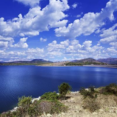 Tranquil Lake Against Cloudy Sky, Sardinia, Italy--Photographic Print