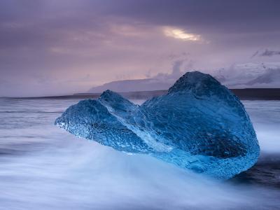 Translucent Blue Iceberg Washed Ashore on Breidamerkursandur Black Sands-Patrick Dieudonne-Photographic Print