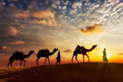 Travel Background - Two Cameleers (Camel Drivers) with Camels Silhouettes in Dunes of Desert on Sun-DR Travel Photo and Video-Photographic Print