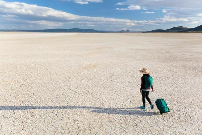 Traveler Rolls A Carry-On Suitcase, The Playa In The Alvord Desert Of SE Oregon-Ben Herndon-Photographic Print